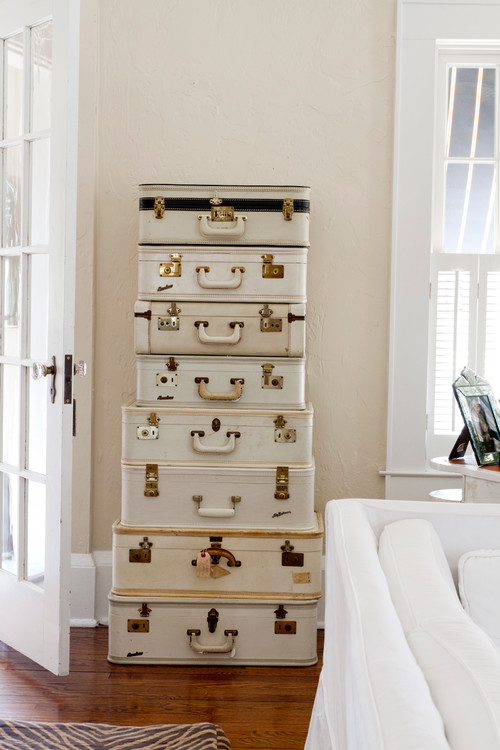 Stacked Vintage Creamy White Suitcases Act as Storage