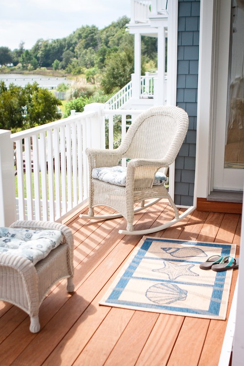 White Wicker Rocking Chair on Balcony