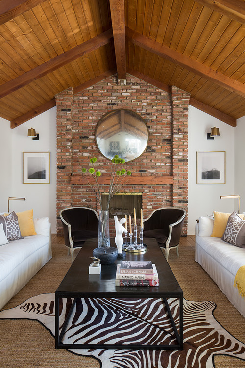 Brick Fireplace and Wood Vaulted Ceiling in Living Room