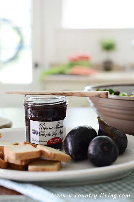 Purple Fig Spread and Whipped Ricotta Cheese on Crackers