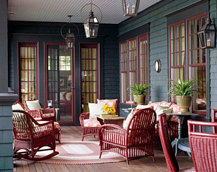 Burgundy wicker furniture on back porch