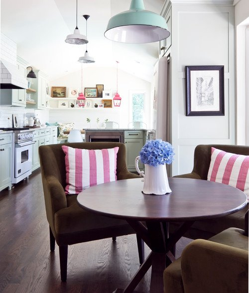 Round Wood Table with Upholstered Chairs in Breakfast Nook