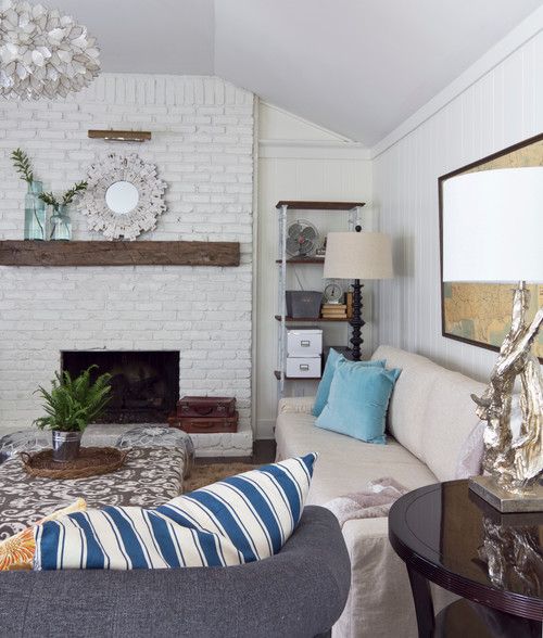 Cottage Style Living Room with White Painted Brick and Paneling