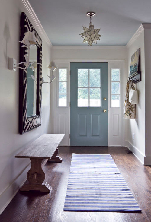 Seventies Ranch Entryway with blue door and wooden bench