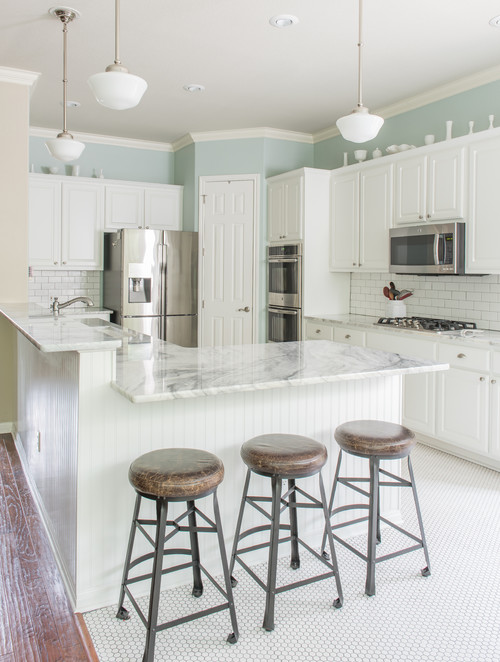 Farmhouse Kitchen with White Cabinets and Pale Blue Walls