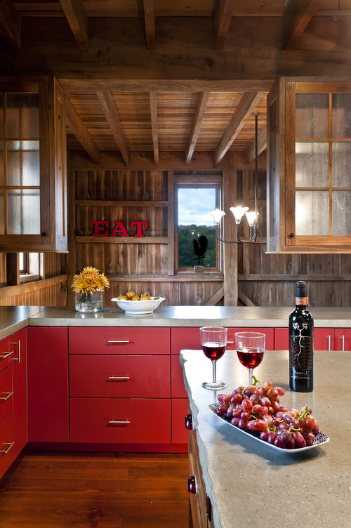 Red decorating in a rustic kitchen