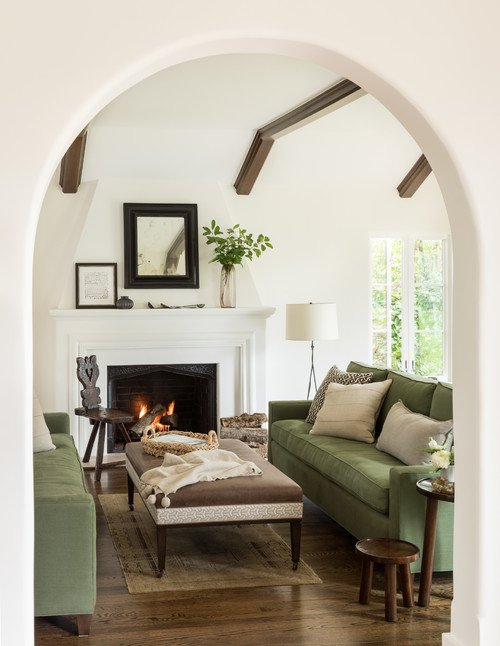 Mediterranean Living Room with Green Couches and White Fireplace