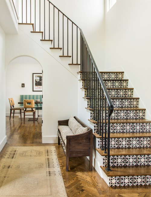 Mediterranean Style Entryway with Tiled Staircase