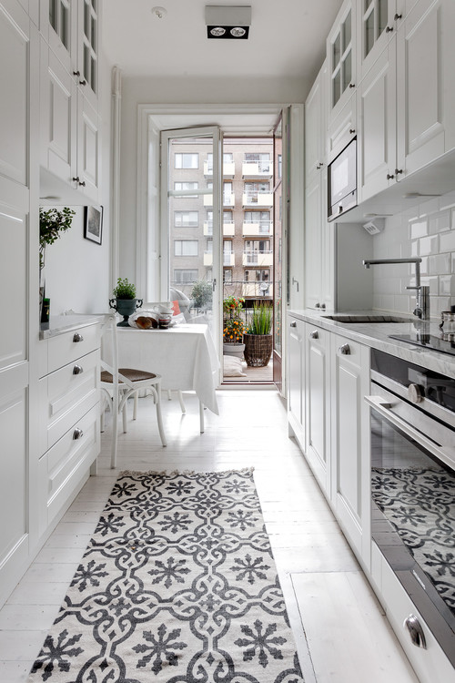 All White City Apartment Galley Kitchen