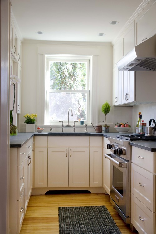 Kitchen with White Cabinets and Dark Gray Stone Counter Top