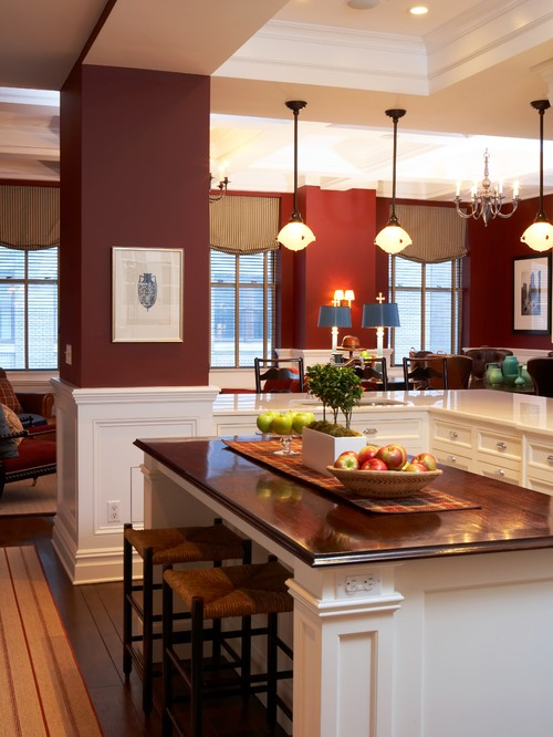 Traditional Kitchen with Cream Cabinets and Burgundy Walls