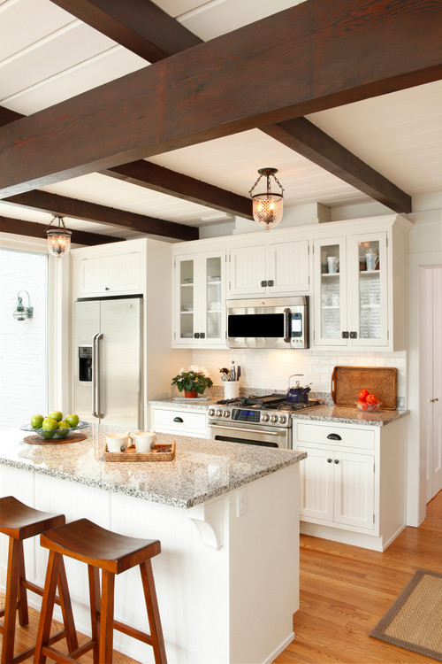 Traditional white kitchen with wood beam ceiling