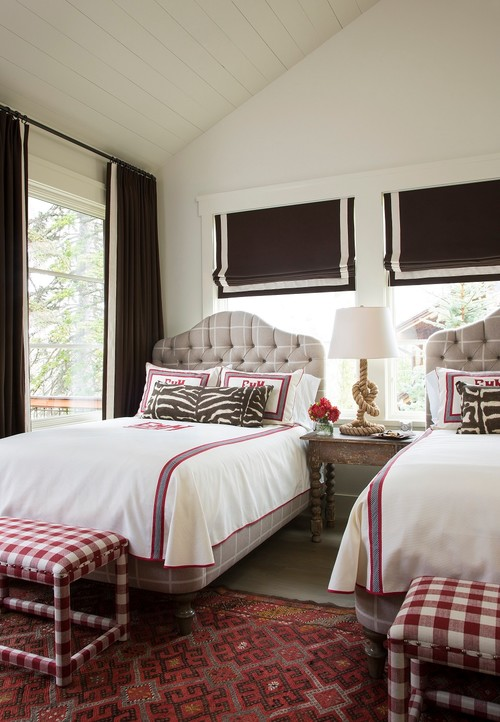 Brown and red bedroom with vaulted ceiling