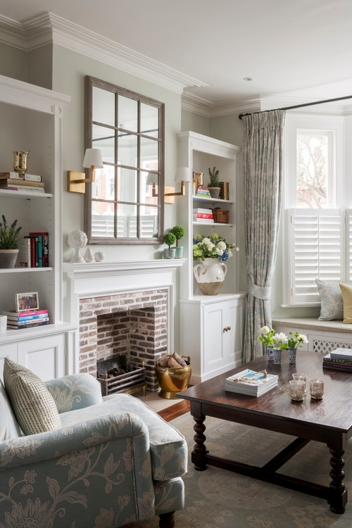 Renovated Townhouse in London features soft colors and a beautiful brick fireplace with white mantel