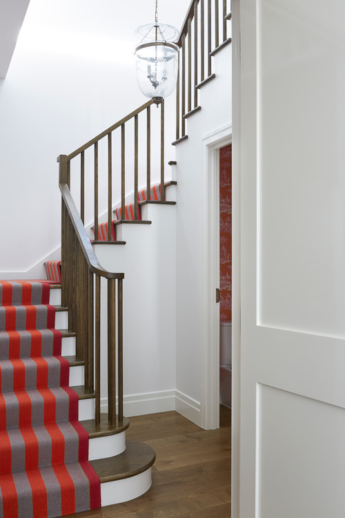 Traditional Staircase with Red Striped Carpet Runner
