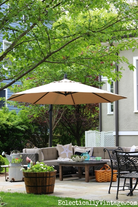 Outdoor Patio with Oversized Umbrella by Eclectically Vintage