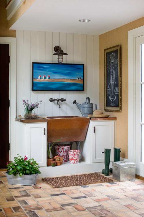 Beach Style Mudroom with Brick Floor