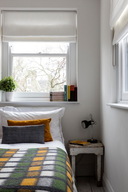 Small Historic Bedroom with White Walls and Wool Blanket