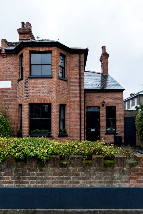 Old and Charming English Brick Cottage with Black Trim