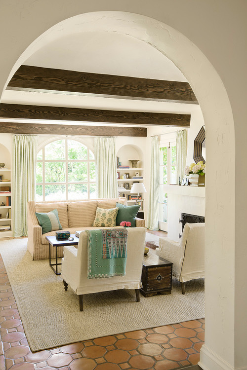 Mediterranean Living Room with Wood Ceiling Beams and Arched Doorway