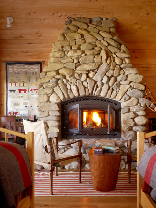 Stone Fireplace in Rustic Cabin Bedroom