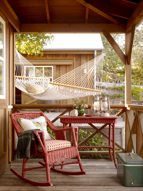 Cabin Porch with Red Wicker Furniture