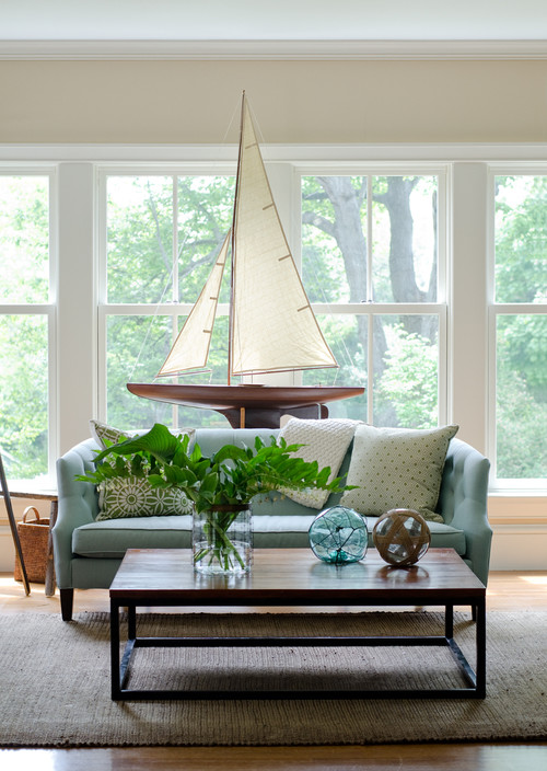 Modern Blue Sofa with Large Sailboat Decor