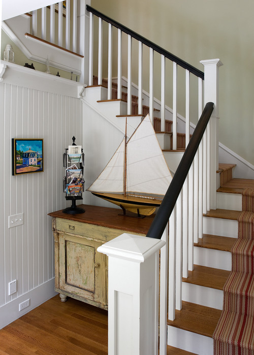 Traditional Staircase with Buffet and Sailboat Vignette