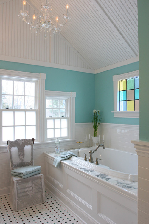 Blue Bathroom with Garden Tub and Stained Glass Windows