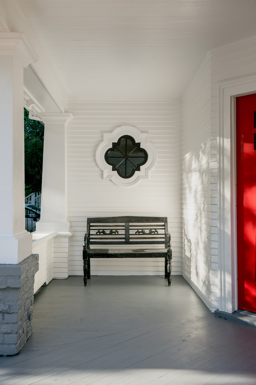 White Victorian Porch with Red Front Door
