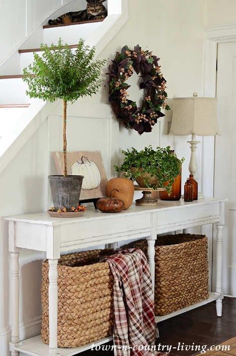 Fall Berries Grapevine Wreath Above Console Table