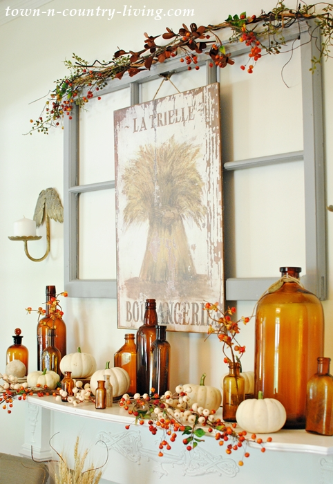 Vintage Fall Mantel with Brown Bottles