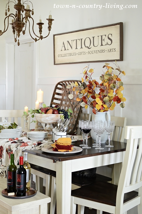 Fall Buffet Table with White Dishes and Autumn Accents