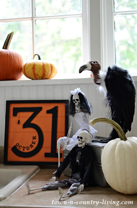 Halloween Vignette with Skeletons and Vulture