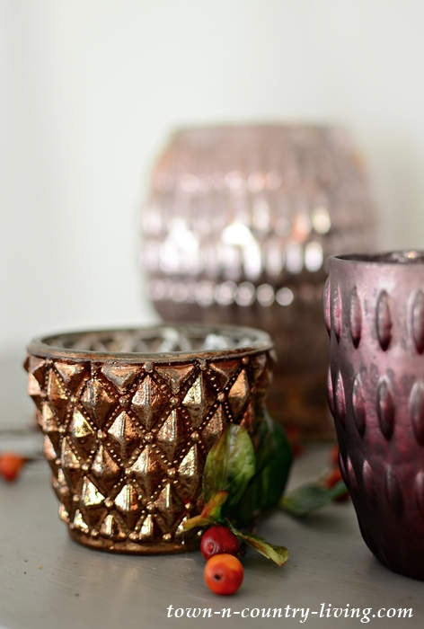 Copper, Rose, and Burgundy Candle Holders for a Fall Mantel