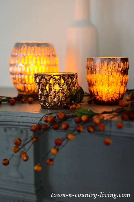 Create a Golden Autumn Glow on a Fall Mantel with Candle Holders from Pottery Barn