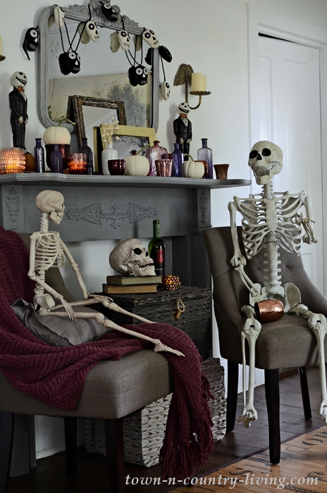 Halloween Decor with Skeletons and Decorated Mantel