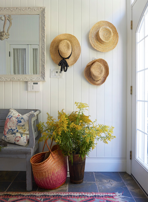 Decorate with hats by putting them on display in an entryway
