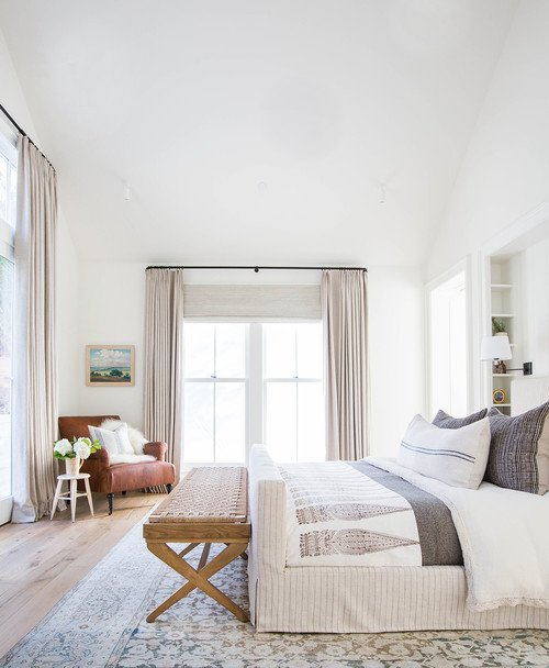 Casual Neutral Bedroom with Vaulted Ceiling
