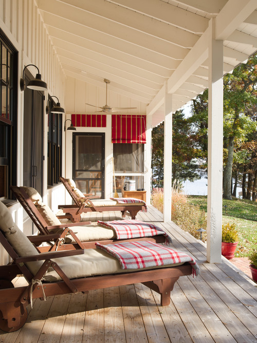 Large Outdoor Porch with Lounge Furniture and Plaid Blankets