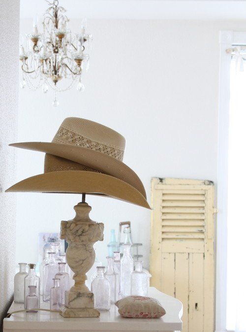 A pair of hats on a hat stand in a bedroom