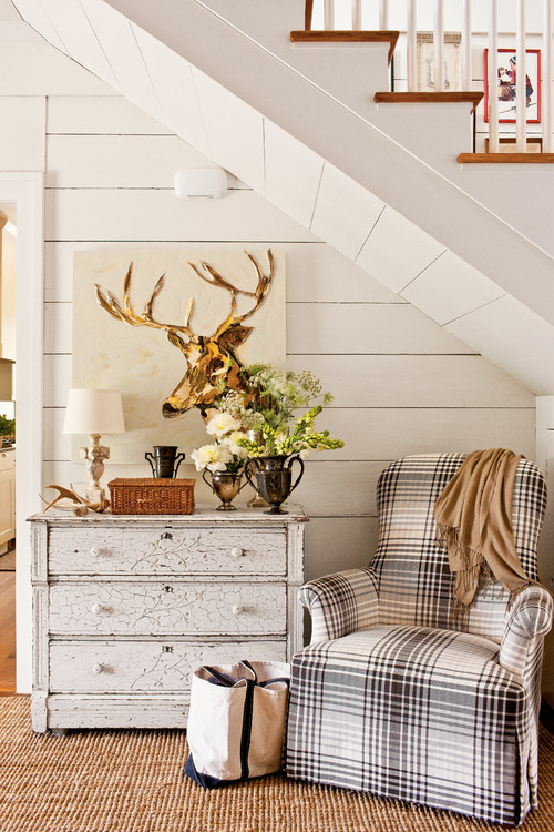 Cozy Reading Corner under Stairway with Plaid Chair