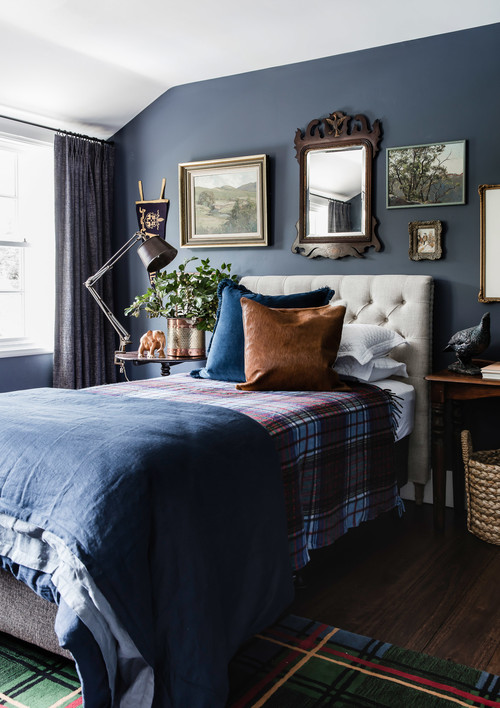 Cozy Dark Blue Bedroom with Plaid Blanket and Rug