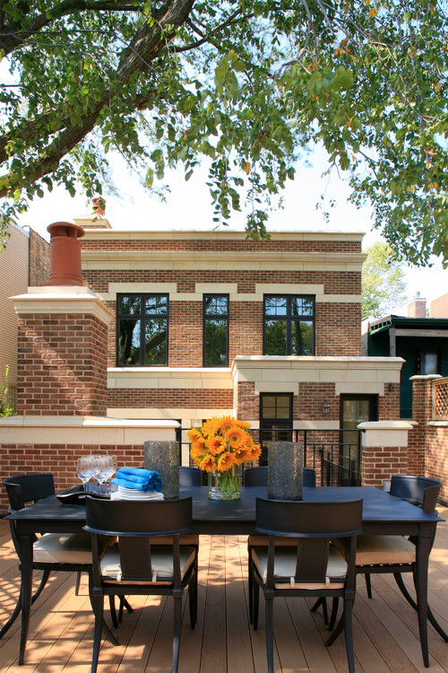 Chicago City Living in a Brick and Limestone House with Outdoor Deck and Dining