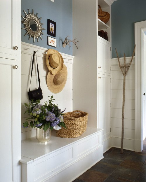 Straw hats on display in a mudroom