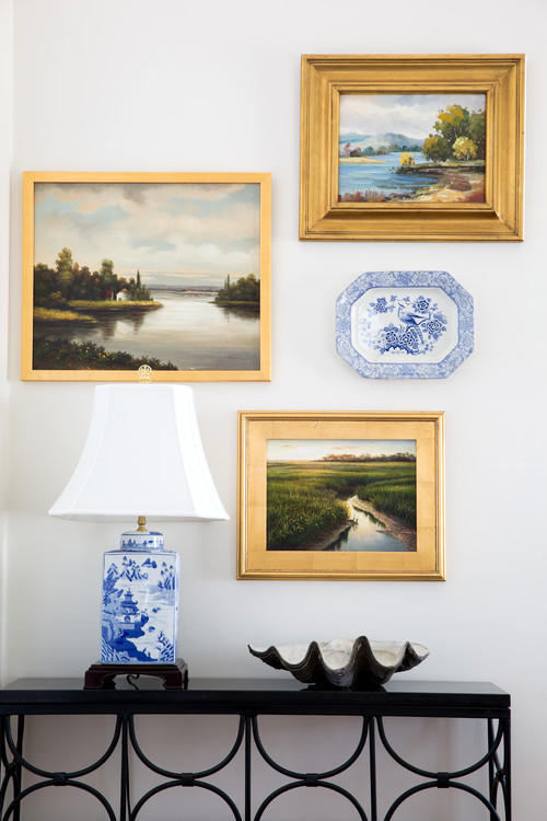 Collection of Landscape Paintings in Hallway