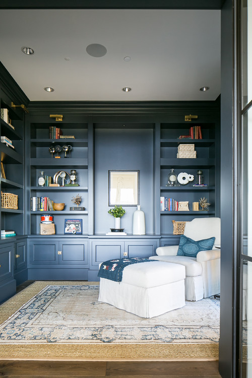Navy Blue Den with Built-in Shelves and Cozy Chair and Ottoman
