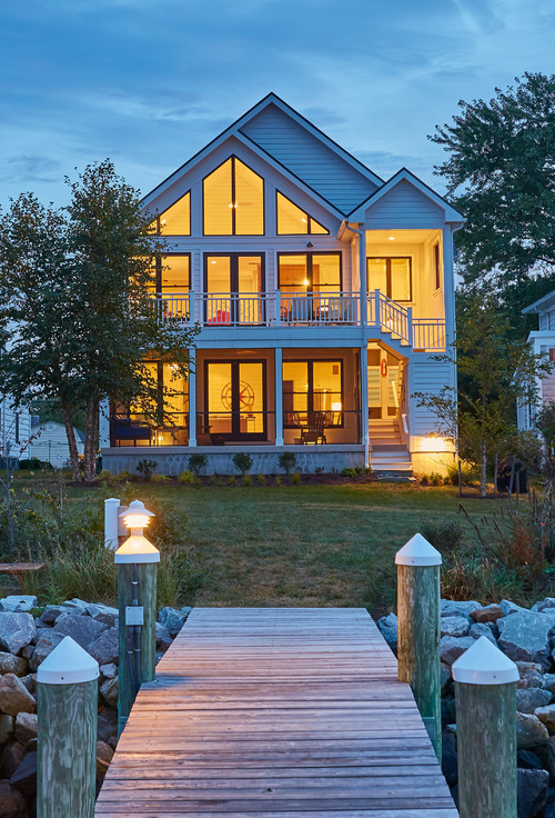 Lakeside Home with Dock Lit Up at Night