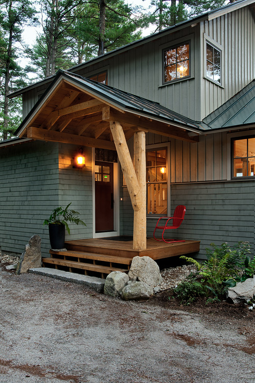 Rustic Green Home with Nighttime Curb Appeal