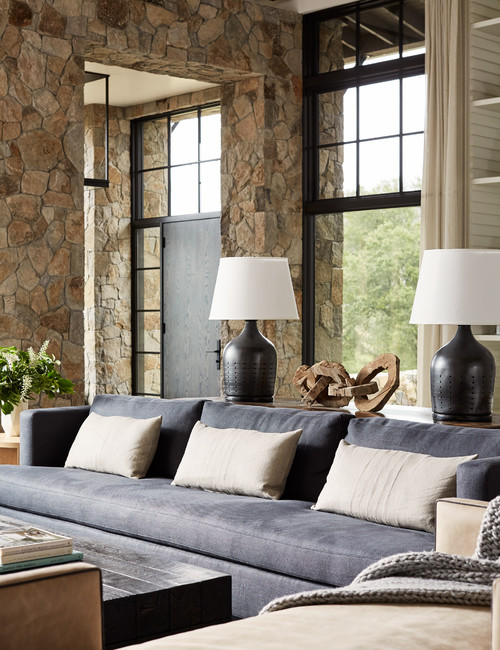 Rustic Living Room with Stone Walls and Black Metal Windows